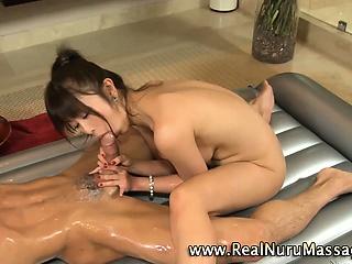 Petite asian masseuse rides cock