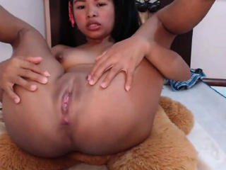 Asian girl with vibrating dildo masturbating