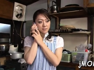 Pretty asian grown up plays with water on her moist cum-hole