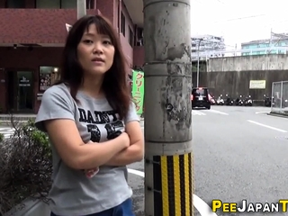 Asian pees a stream onto trip